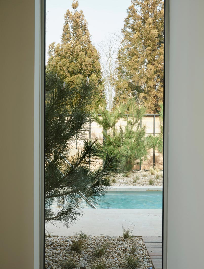 view of pool from indoors