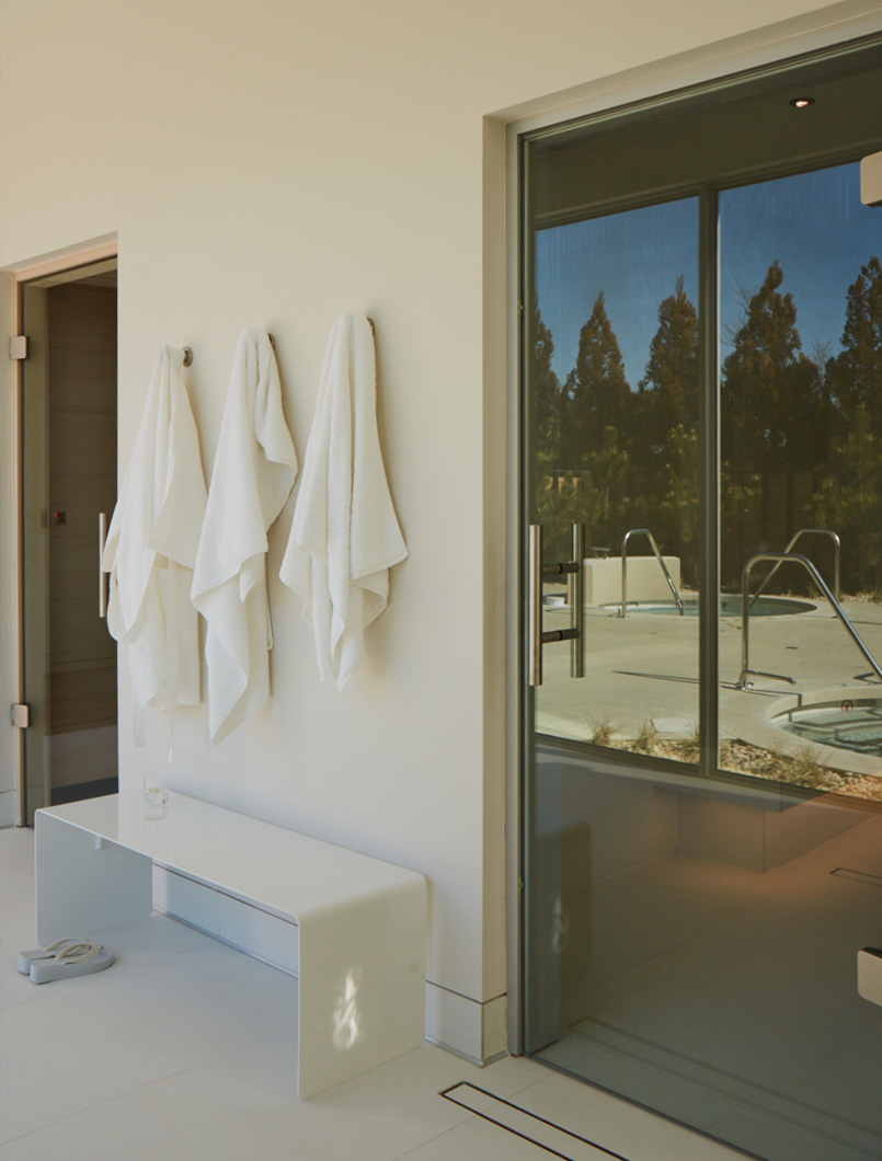 robes hanging by pool